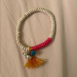 Beaded bracelet with tassels and pearls